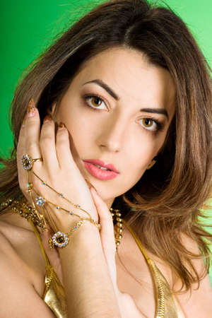 beautiful woman with golden beads  photo