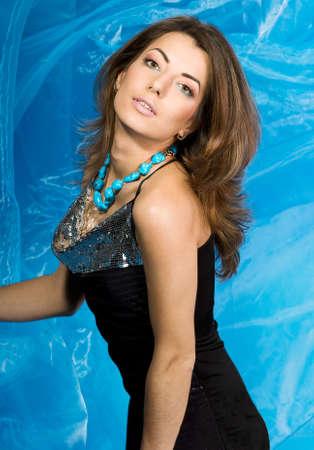 beautiful woman with blue silk fabric  photo