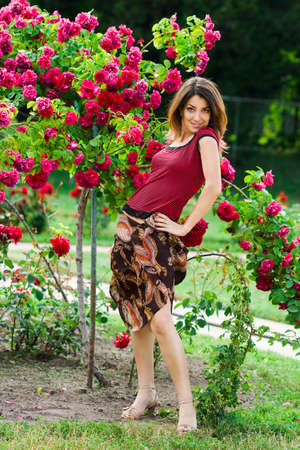 beautiful woman in garden with roses  Stock Photo - 3912063