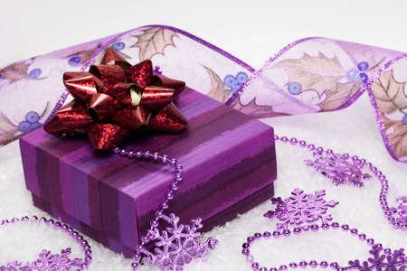festive snowflakes with gift box on snow Stock Photo - 3916656