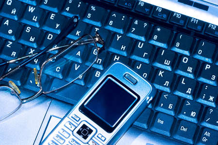 Mobile phone and glasses on computer keyboard (business conception) Stock Photo - 3916711