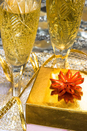 glasses with champagne and gift box  photo