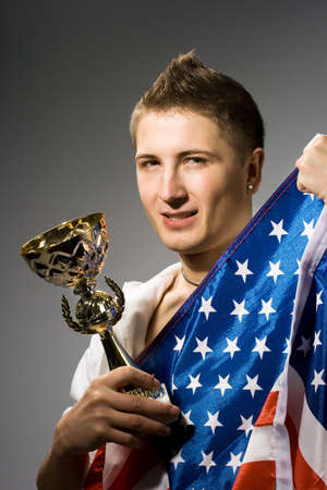 winner with American flag and golden trophy photo