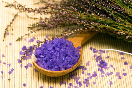 Spa essentials (bath salt in a spoon and flowers of lavender)  Stock Photo