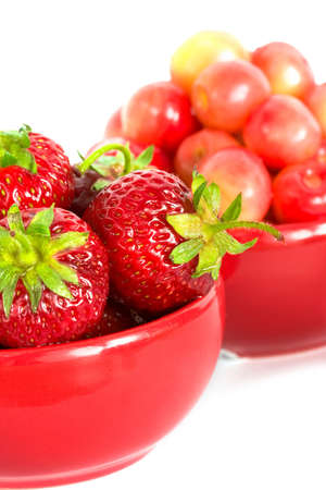 strawberry and chery on red plates  Stock Photo - 3941255