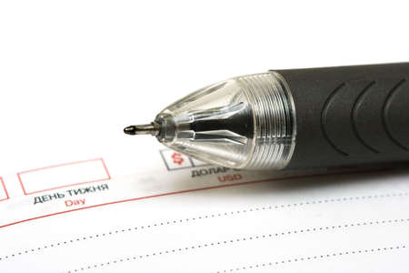black pen with notebook on white Stock Photo - 3941237
