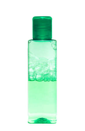 cosmetologist: green bottle with shampoo on white background
