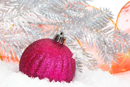 pink Christmas balls on snow background  photo