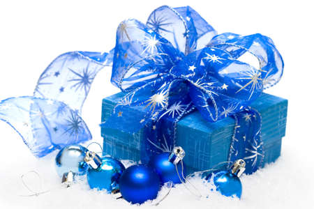 festive balls with gift box on snow  photo