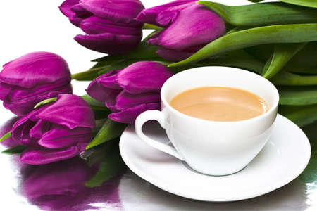 white cup of coffee with violet tulips  photo