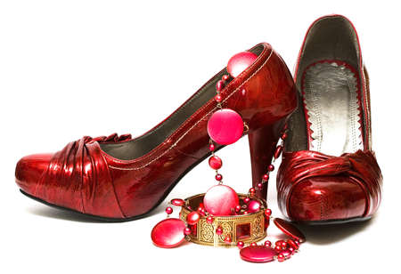 entice: red shoes and decorations isolated on white background