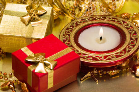 gift boxes and burning candle  Stock Photo - 4342505