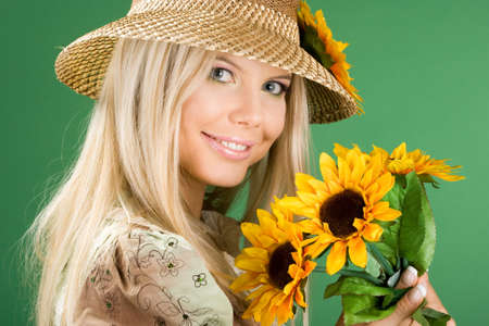 portrait of pretty woman with sunflowers  photo