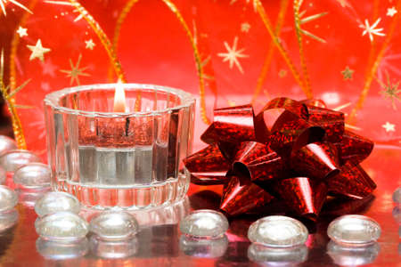 festive candles with red bow  Stock Photo - 4348439