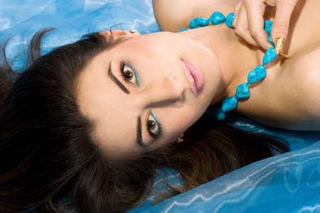 beautiful woman with blue beads  photo