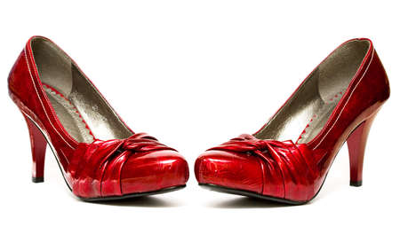 entice: red womanish shoes isolated on white background