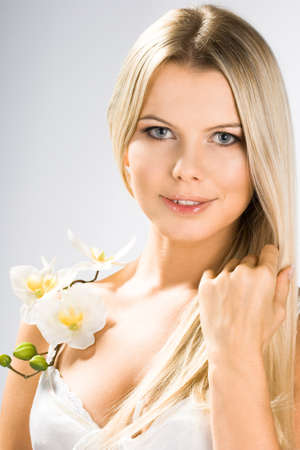 portrait of pretty woman with white orchids Stock Photo - 4348118
