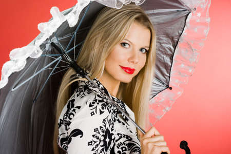 girl with umbrella on red background  photo