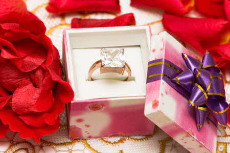 diamond ring in beautiful box with flowers  photo