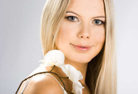 portrait of pretty woman with white orchids Stock Photo - 4384790