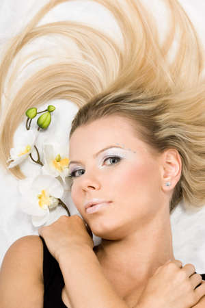 beautiful woman with white orchids  Stock Photo