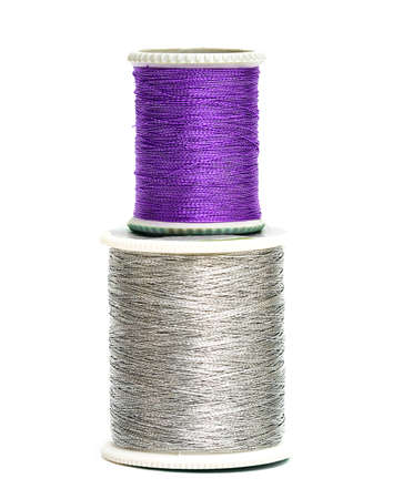 violet and silver spools of threads  photo