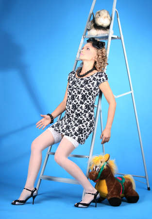 girl doll on a step-ladder  photo