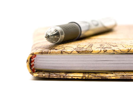 academia: black pen with notebook isolated on white background
