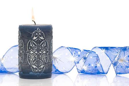 blue burning candle on white background  photo