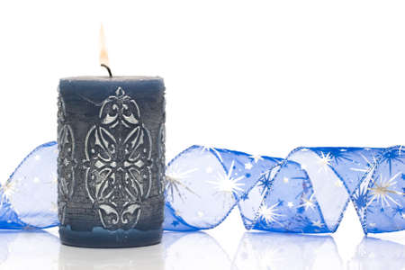 blue burning candle on white background  photo