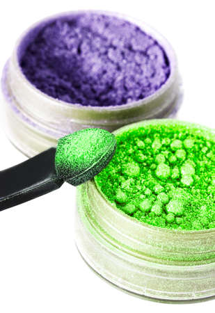 green and violet make-up eyeshadows and cosmetic brush  photo