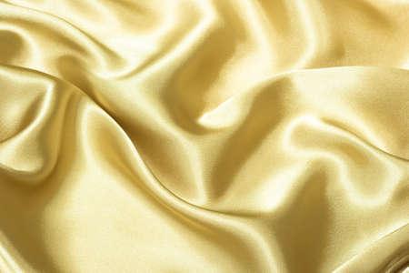 tissu or: la texture du tissu de soie pour le fond