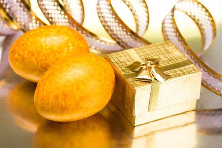 Easter eggs with golden gift box Stock Photo - 4664513