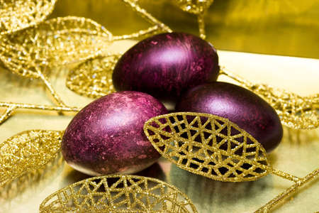 Easter eggs with golden leaves  photo