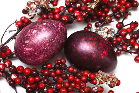 Easter egg with red berries  photo