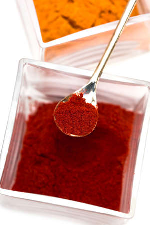 Spice of red pepper and turmeric isolated on white background Stock Photo - 4764448