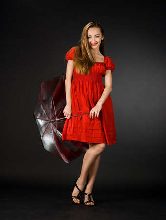 pretty girl in red dress with umbrella  photo