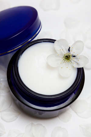 cosmetic moisturizing cream with flower  photo