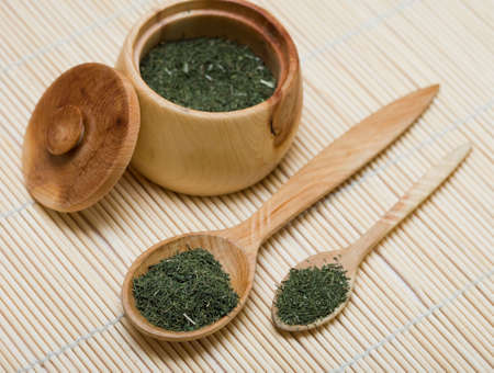 Spice of thyme in spoon and bowl  photo