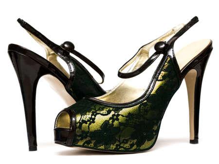 entice: womanish shoes isolated on white background