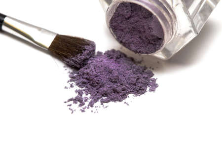 violet make-up eyeshadows and cosmetic brush