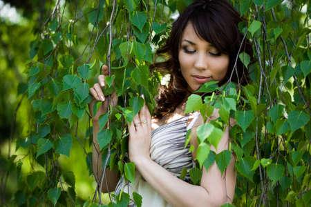 beautiful girl in a birchwood Stock Photo - 4926499