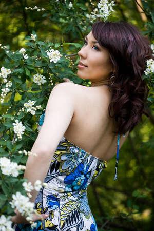 tender girl in the garden with flowerings trees  Stock Photo - 4926464