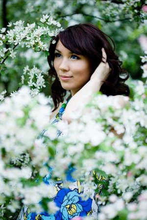 tender girl in the garden with flowerings trees Stock Photo - 4926486