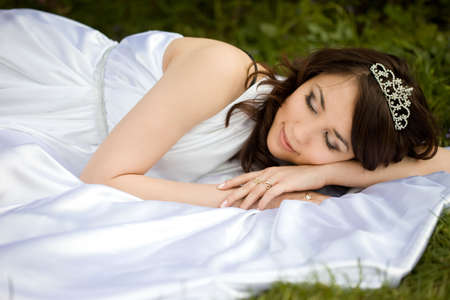 asleep beautiful woman in the fairy-tale forest  Stock Photo