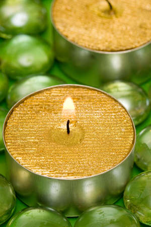 golden candles with green decoration balls photo