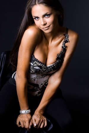 Sexy fashionable woman on black Stock Photo - 5971205
