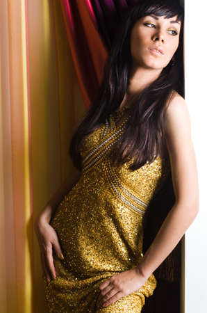 Sexy fashionable woman in golden dress Stock Photo - 5971206