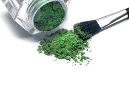 green make-up eyeshadows and cosmetic brush  photo