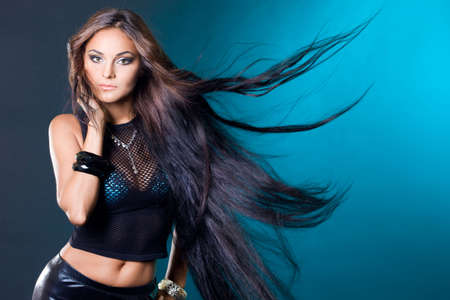 beautiful fashionable woman with long hair photo